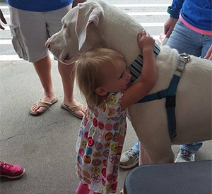 Gallery 2_0003_PFP-Gallery - Little Girl Hugging Dog